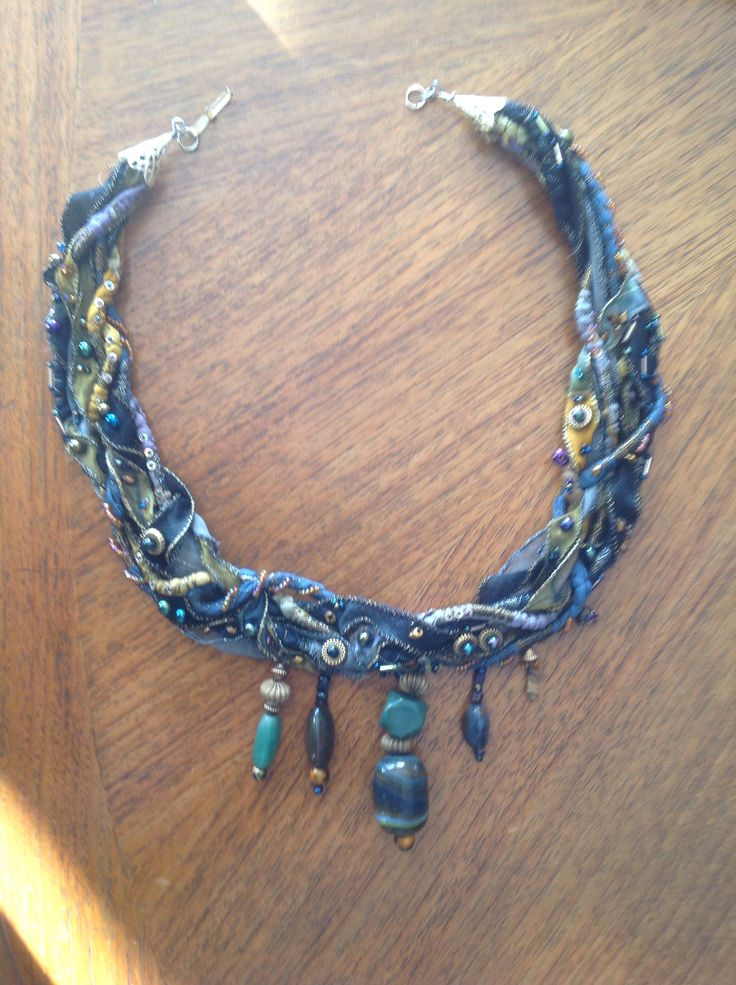 Fabric manipulation and beads by Margaret Roberts.