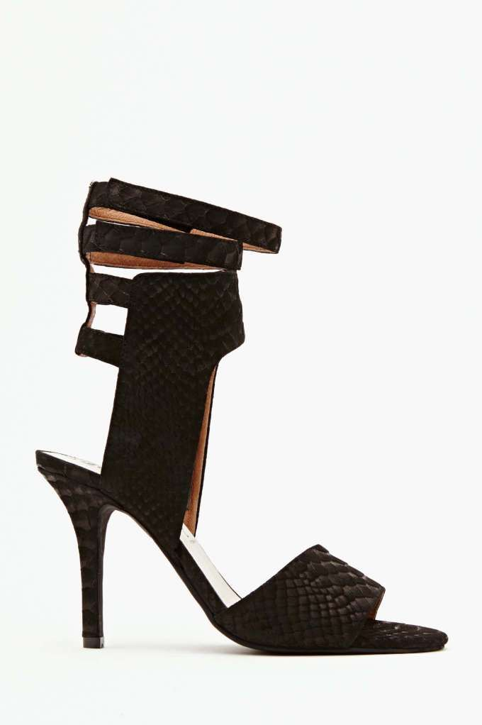 Insanely chic black snake-embossed suede heel featuring triple high-reaching  ankle strap detailing and a rounded toe.