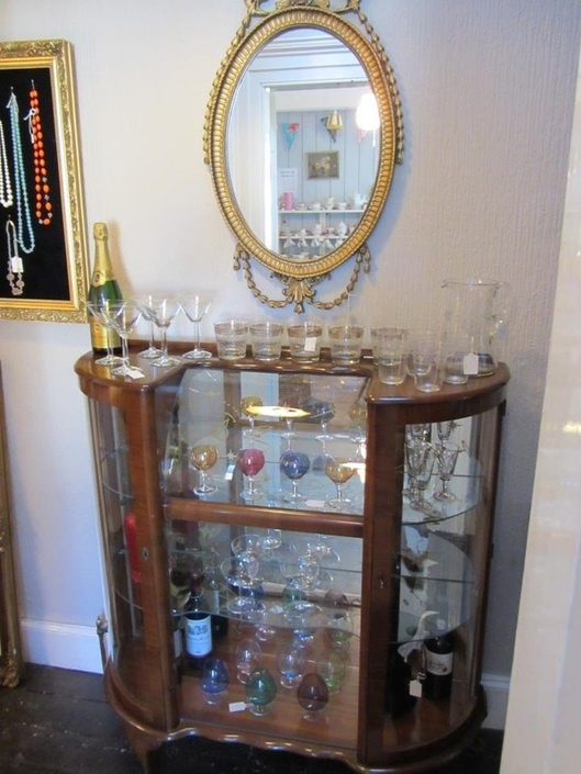 Bar and glassware in china cabinet