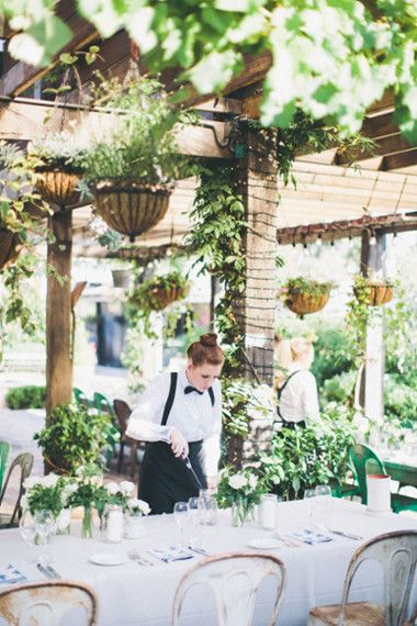 Lighting candles for a wedding at The Grounds of Alexandria, Sydney | Image: And a Day Photography