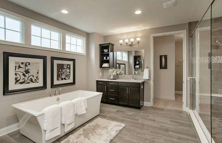 Montagna Dapple Gray wood grain floor tile. Dark vanity ...