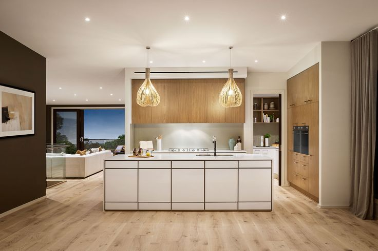The striking kitchen featured in the Severn 4-45 embraces the use of neutral tones and stunning textures. #urbanedgehomes #design #modernhomes #balcony #style #kitchen #meals #interiordesign #interiors #alifewithstyle