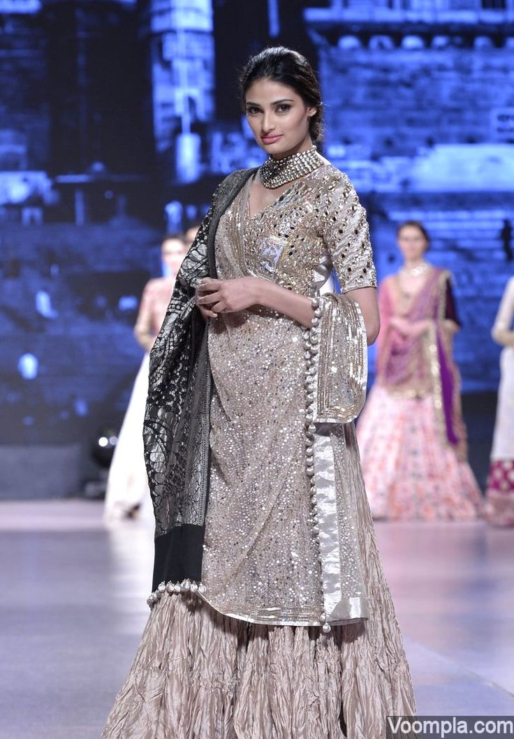 Athiya Shetty's traditional look in a long kurta, sharara and a black dupatta by designer Manish Malhotra. via Voompla.com
