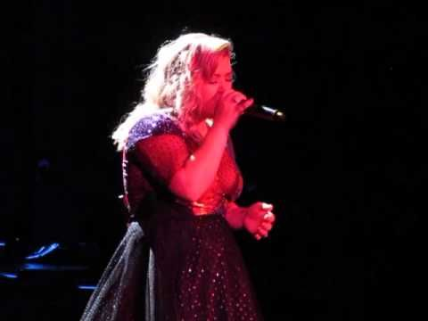 "With only the mournful accompaniment of one piano player, Ms Kelly Clarkson covers ""Jolene,"" that awesomest written and performed, too, by the darling Ms Dolly Parton - - Albuquerque on 27 August y2015"