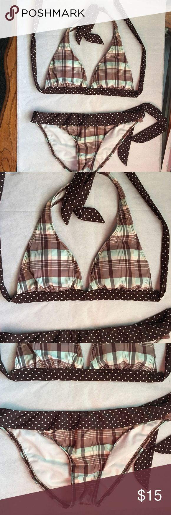 Brown polka dot and check bikini by Split. Size M. Summer is right around the corner so why not make a splash with this cute bikini by Split.  Brown, light blue and cream plaid, trimmed in brown and white polka dots.  Size Medium. Bikini cut bottom with side tie and triangle halter top with soft cup inserts.  Gently loved condition, freshly hand washed and from smoke free home. Split Swim Bikinis