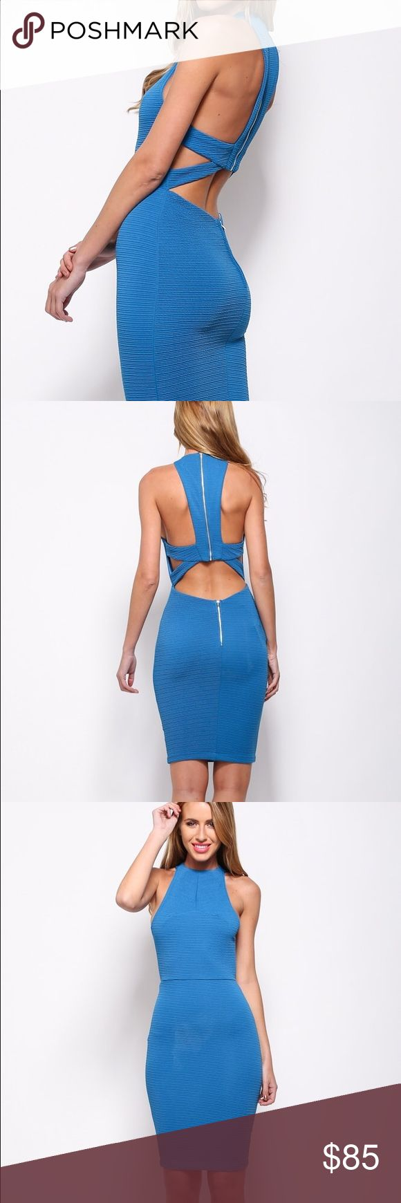 Untouchable dress Cut out dress. High round neckline. Cut outs at side. Visible back zip from neckline. Low cut out back. Low visible back zip. Ribbed fabric. Fitted style with stretch in fabric. Pencil skirt. Not lined. Hello molly Dresses Midi