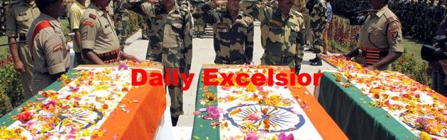 Border Security Force (BSF) officers saluting three BSF soldiers killed in militant attack at Machil sector during wreath laying ceremony in Srinagar..Excelsior\Shakeel-ul-Rehman