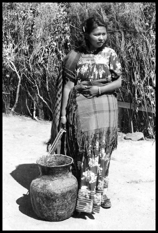 Jicarilla Apache woman with a large ceramic vessel; San Carlos Apache Indian Reservation, Arizona. 1939-50.  No name.