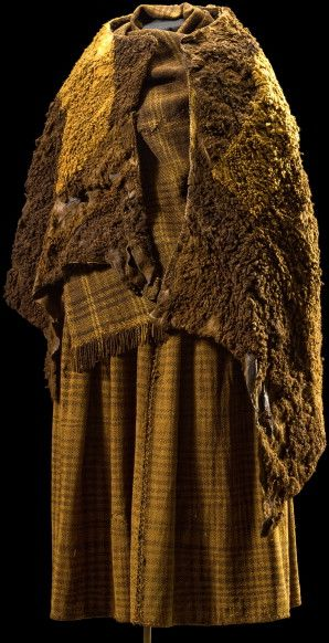 The costume belonging to the Huldremose Woman dated to the Pre-Roman Iron Age.