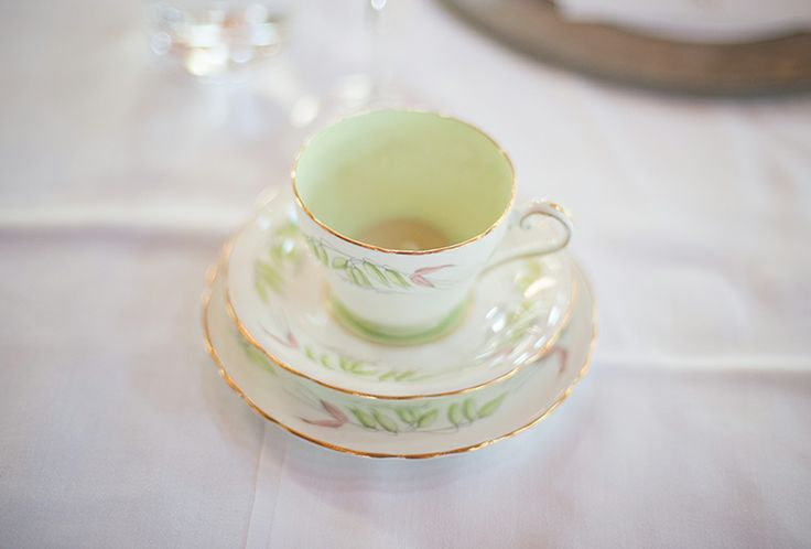 vintage tea cups with tea light candles for the tables