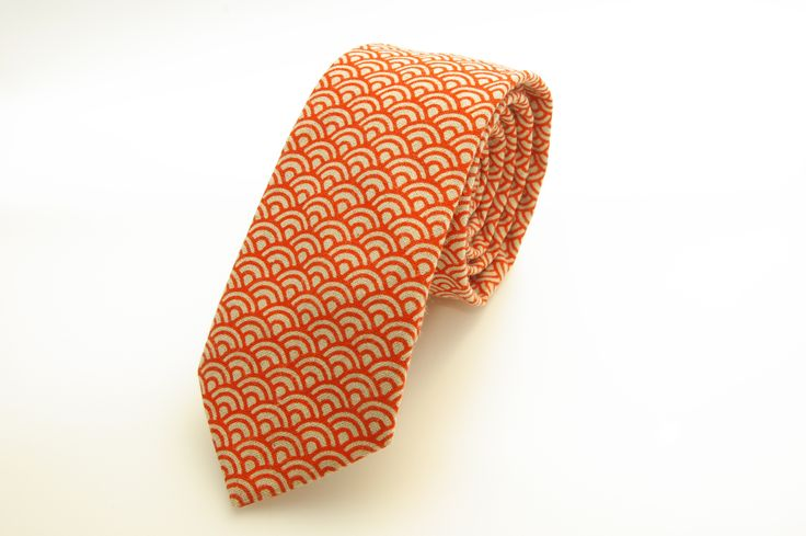 Red linen tie printed in a scallop art deco style pattern. Handmade in Australia by Huxby Haberdashery. Great wedding tie idea