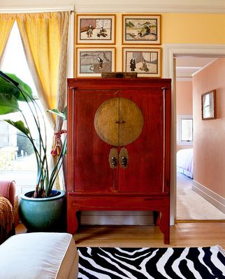 Red Chinese Moon Cabinet, Yellow Walls Benjamin Moore Dalila 319, Zebra Rug  Cost Plus