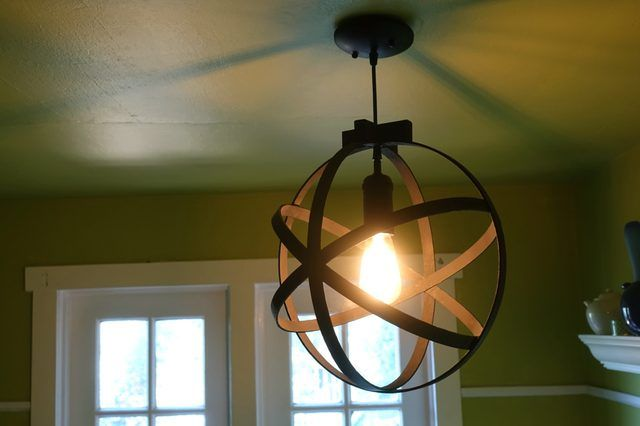 How to make an industrial-style orb light pendant using embroidery/quilting hoops and a pendant light kit.
