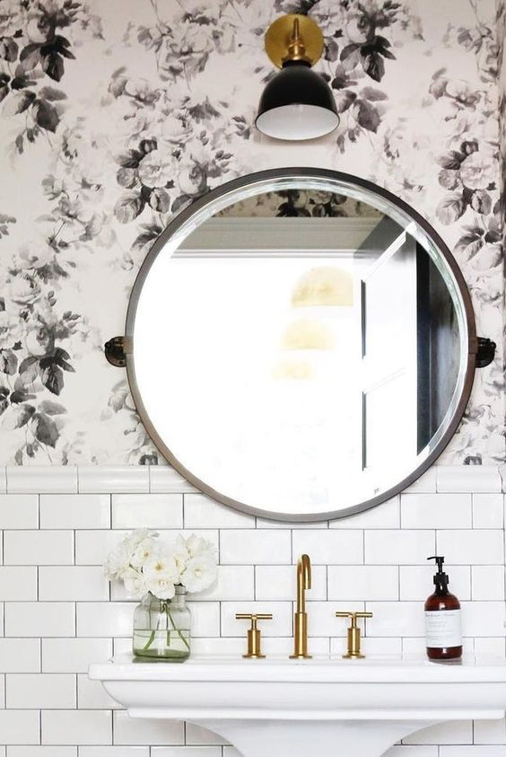 Something about the combination of a round mirror, a single wall sconce, and subway tile (dark grout preferred but not required) feels both very classic but also very now. And as bathroom looks go, it's also very budget-friendly.: