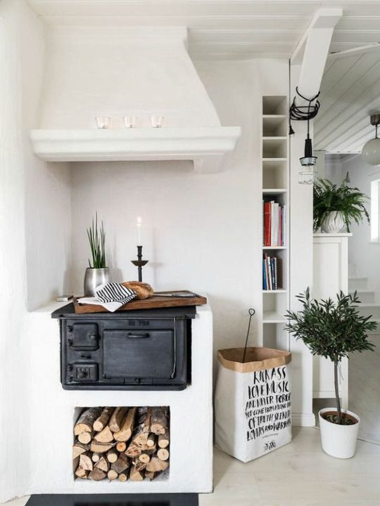 Wood burning stove / oven cooktop. The beautiful plaster walls and stove hood are amazing.