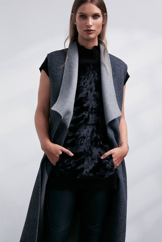 OnceWas: Collectible reversible hand finished sleeveless wool coat and Yumi fur front funnel neck knit.