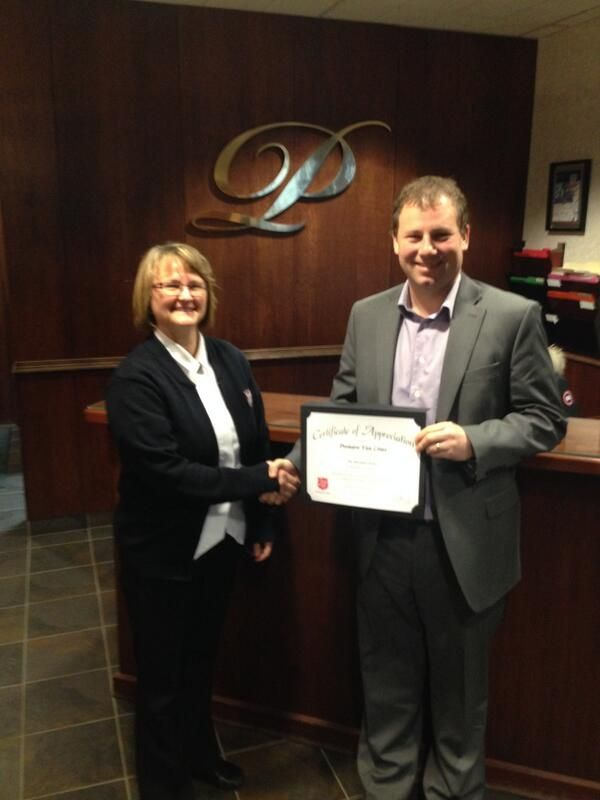 Mjr. Velma Preston presents Jason Buchanan of Premiere Van Lines Halifax with a certificate of appreciation for in-kind donation. The Salvation Army, Maritime Division, has been proudly 'Giving Hope Today' to the Canadian provinces of Nova Scotia, New Brunswick and PEI, for over 125 years.