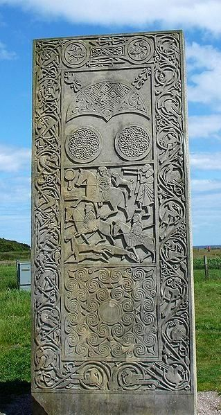 Restored replica of the Hilton of Cadboll Stone; details on the original stone, especially of the Pictish Queen and her huntsmen, are much more weathered.  The Hilton of Cadboll Stone is a Class II Pictish stone discovered at Hilton of Cadboll, on the Tarbat Peninsula in Easter Ross, Scotland.   It is one of the most magnificent of all Pictish cross-slabs. On the seaward-facing side is a Christian cross, and on the landward facing side are secular depictions.