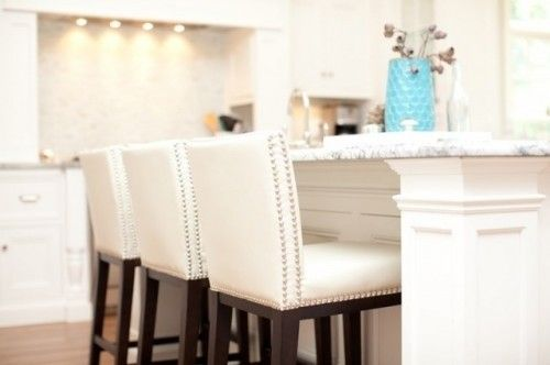 Great white leather bar stools with backs, chrome nail heads.