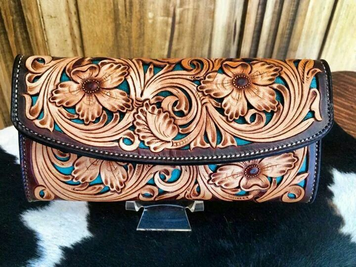 Leather tooled clutch wallet with a turquoise inlay