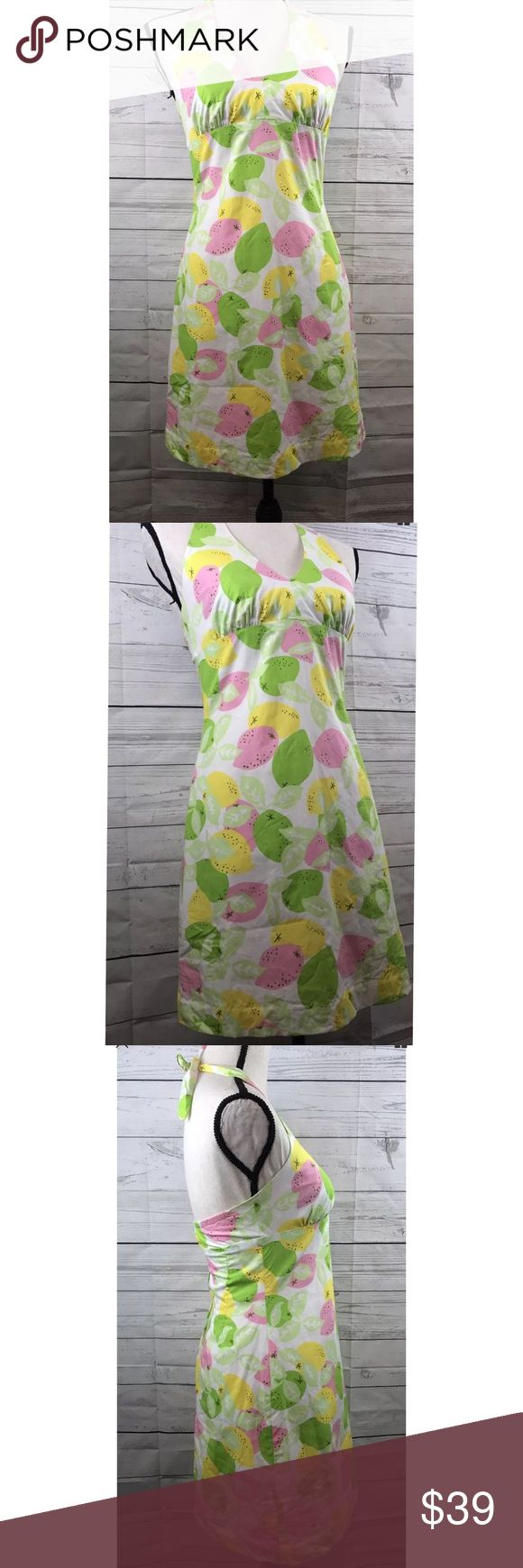 Lilly Pulitzer fruit print lemon lime halter dress Size: 2 Color: Pink Green Yellow Multicolor Neckline: Halter Top Materials: Shell 100 Cotton, Lining 65 polyester, 35 cotton  Measurements in inches laying flat (Approximate) Length (Top of back to bottom laying flat): 23 Underarm to Underarm (Laying flat): 15 If you have specific questions concerning measurements please feel free to ask me. Measurements are taken by hand and are approximate and may not be exact.   Condition: Used condition…