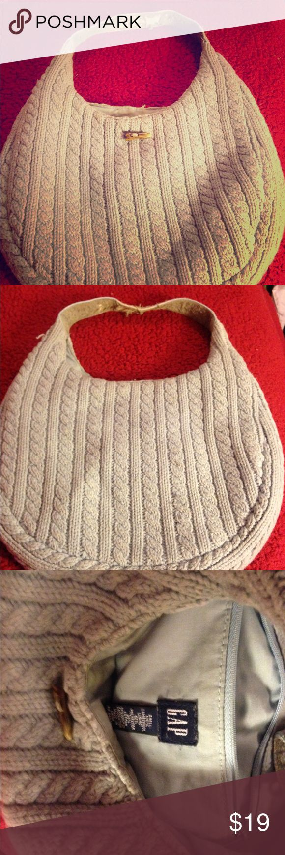 Gap sweater purse!!!👜 Baby blue Gap purse!!! (100% lambs wool lining 62% polyester 38% cotton) wear & tear of strap shown in photos. Lining has stains. Will let you all know if I'm able to remove the stains. Other than those 2 things there's nothing wrong with the bag. No zippers. GAP Bags Shoulder Bags