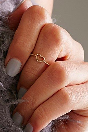 A little midi ring is a clever way to sneak a bit of heart into your look. Also: STACKING YES YES PLEASE. | 17 Pieces Of Irresistible Tiny Hearts Jewelry