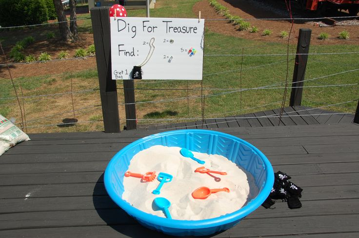 Dig for Treasure!- We used a plastic kiddie pool filled with Sandbox sand. I filled the box with an array of pirate swag. Gold necklaces, plastic jewels, pirate rings, and gold coins! I gave each pirate a treasure bag and they went digging!