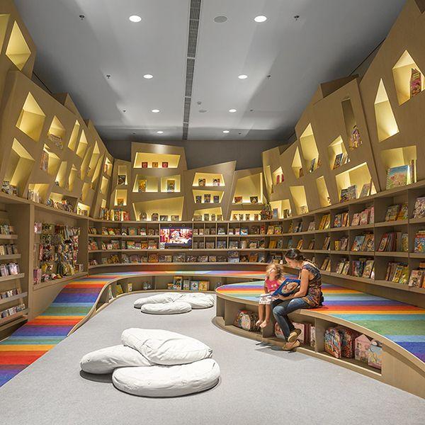 Child's Play: Arthur Casas Designs A Rainbow Twisted Kids Book Den for Saraiva