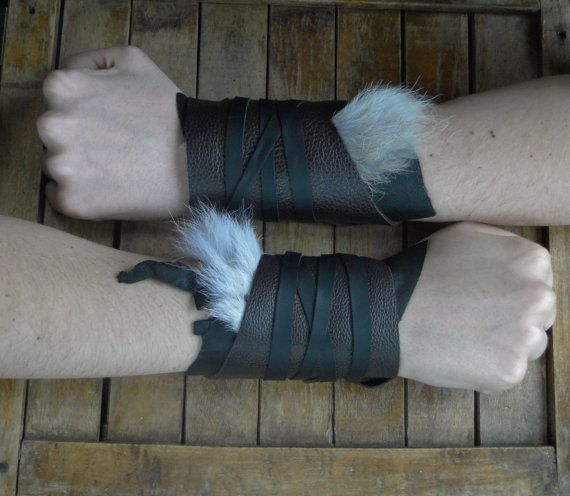 Ready to ship -- You will receive the exact pair of cuffs shown in the first two pictures -  Add amazing quality, detail and a finished look to your costume! Great for any Viking, Warrior, Barbarian, or Archer...Handmade with high quality soft genuine leathers & furs. They wrap around and secure with a long attached leather tie; making them adjustable to any wrist size, comfortable to wear, and easy to put on. Can be worn by men or women, interchangeable for left or right hands. Each pair…