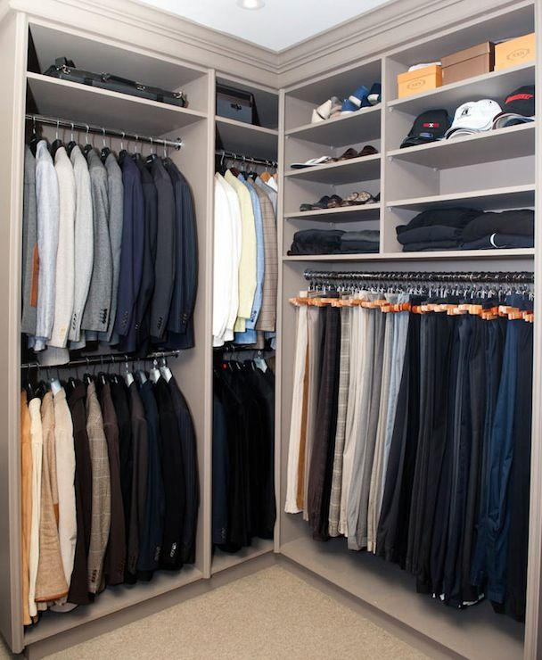 Brian Gluckstein - masculine gray closet with clothes rail storage and shelves for shoes, sweaters and hats.