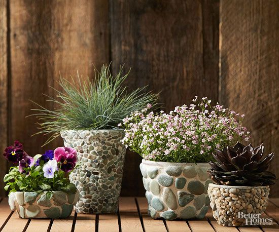 Give simple store-bought pots an all-natural, expensive look with just a few simple steps. Seal your pot using outdoor spar urethane. Use a utility knife to cut a sheet of pebble mosaic tile to fit a tapered pot, cutting out and placing individual pebbles as needed. Wearing waterproof gloves, spread construction adhesive lightly