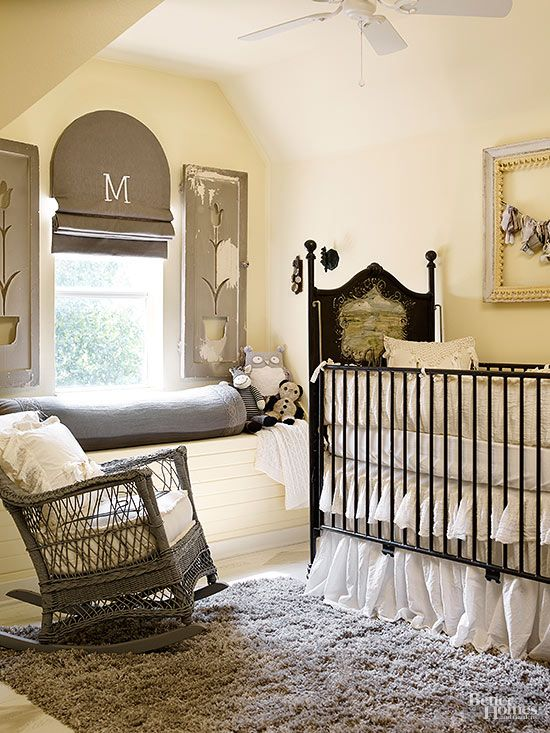 Sometimes the most striking schemes are the simplest, as proved by this nursery swathed in black and ivory. With color stripped out, the focus turns to each lovely piece, from the antique crib painted with a pastoral panel, to the shutters with tulip cutouts, to the stately Roman shade monogram. All of it is prim and elegant like the best English cottage interiors.