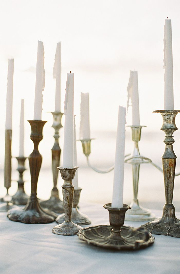 Warm Coastal Wedding Inspiration. Brass candlesticks.