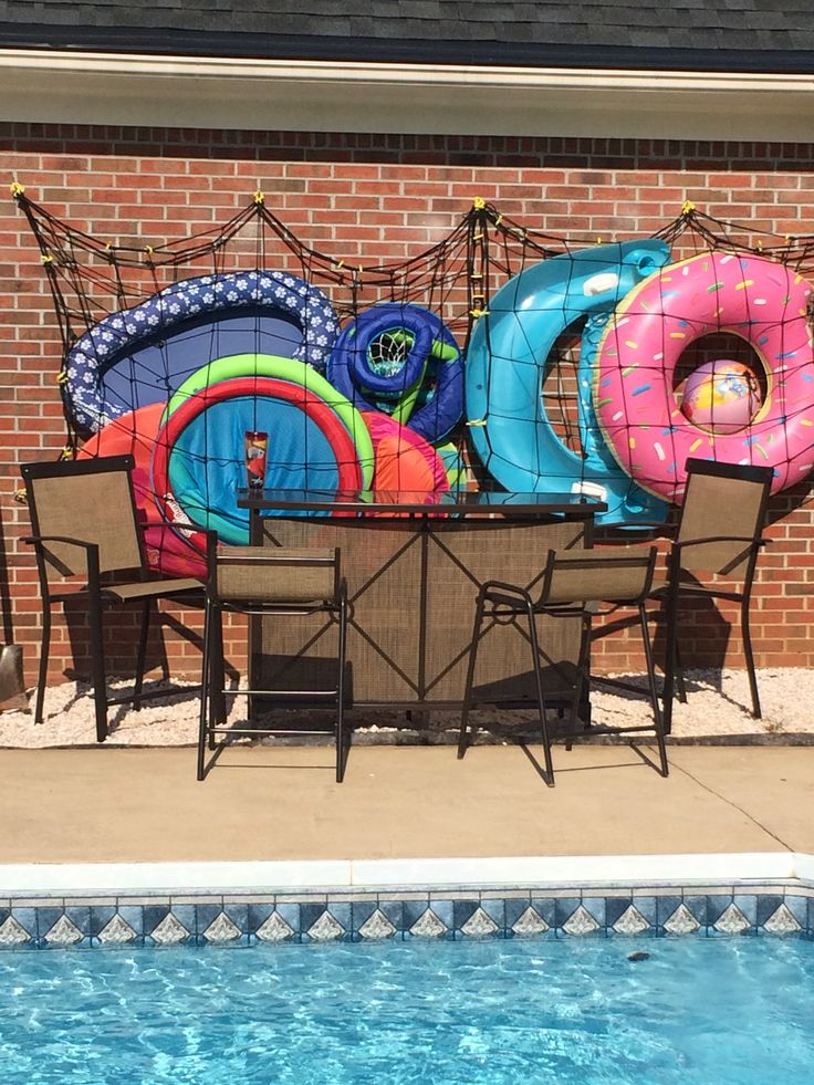 Our solution for a backyard bar / cargo net swimming pool float storage area