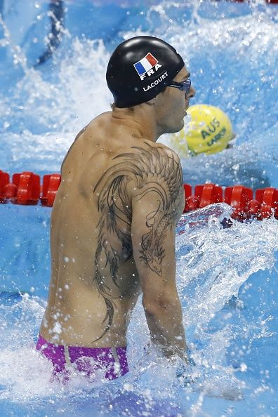 France's Camille Lacourt competes in the Men's 100m Backstroke Semifinal during the swimming event at the Rio 2016 Olympic Games at the…