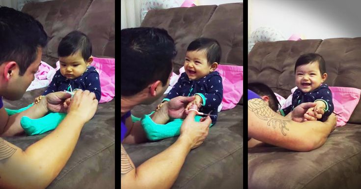Baby pranks daddy when he's clipping her nails - Funny Video