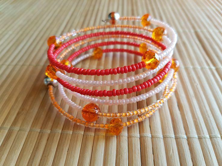 Handmade memory wire bracelet in orange and white by LynnesEbooks on Etsy