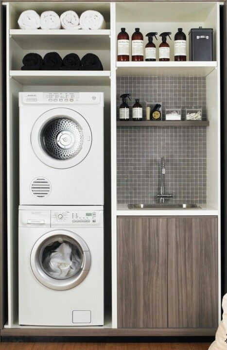 Example of concealed laundry proposed for cupboards in front entrance with fold back doors. Washing machine does not have to be stacked if enough room.Existing cupboards to be extended to accommodate white goods and sink.