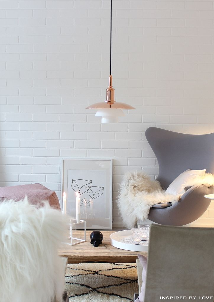 Lovely minimalist Scandinavian design // white brick walls // gray chair // living room inspiration