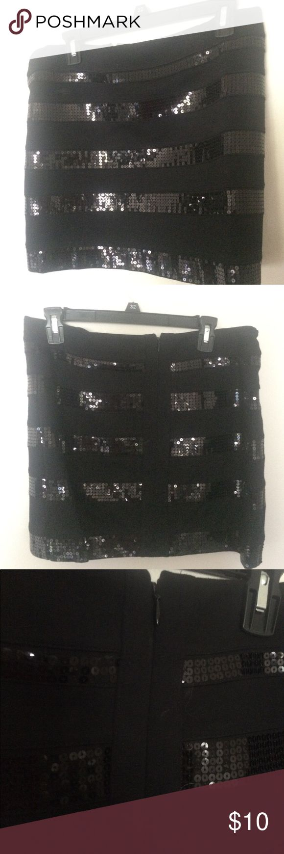 Express Sequin Mini Skirt Black mini skirt from Express with sequin detailing. Back zip closure. Size 12, stretchy fit. Express Skirts Mini
