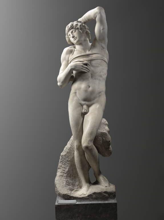 """Michelangelo BUONARROTI dit MICHEL-ANGE Caprese (Arezzo), 1475 - Rome, 1564  Captif (""""l'Esclave mourant"""")  Marbre H. : 2,28 m.  Exécuté en 1513 - 1515 pour le tombeau du pape Jules II. LOUVRE"""