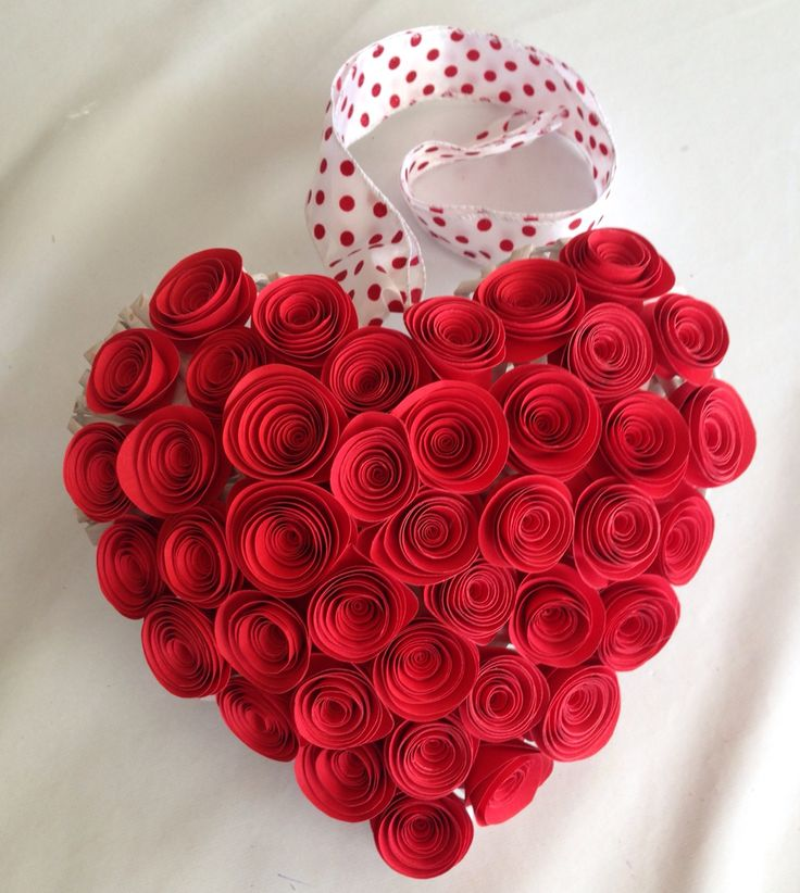 Red paper flowers on a heart