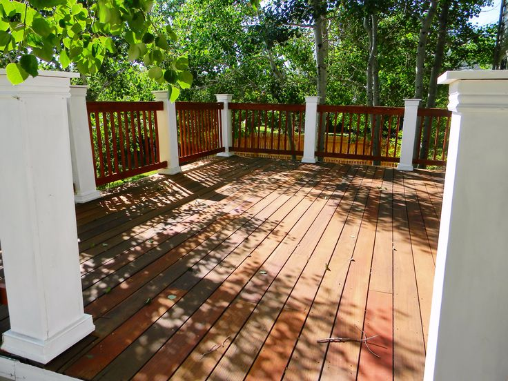Teak Wood Deck Refinish and railing rebuild, stained with Armstrong and Clarke Mahogany hardwood stain.