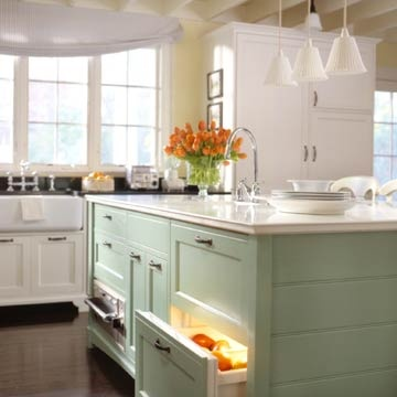 I like the contrast of the sage green with the white in this kitchen.  Also love all the windows and natural light.