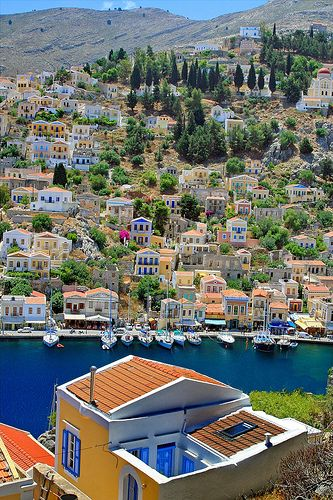 Shores with neoclassical architecture at Yialos, Symi island, Greece.