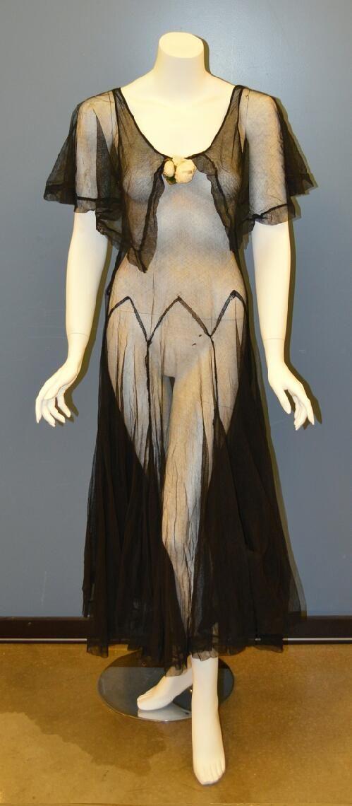 Woman's black net dress with cape sleeves and zig-zag dropped waist seam, circa 1926. | Missouri History Museum #vintage #vintagefashion