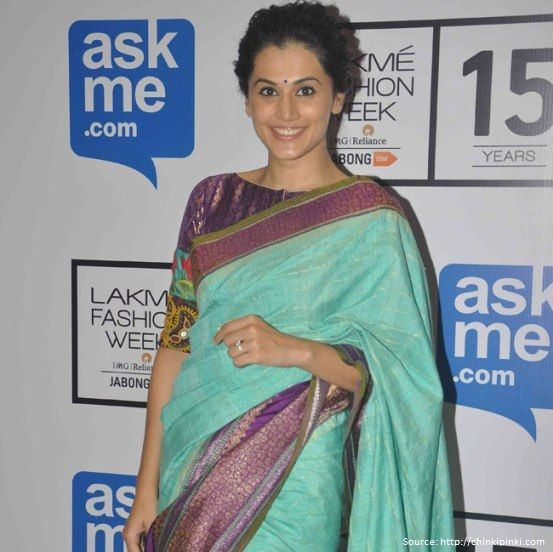 #TaapseePannu, is wearing a ravishing blue and #purplesilksaree. The point here, is that the blouse is in a boat neck shape and it is making a difference to the #saree. Blouses, today can be the showstopper for your saree.