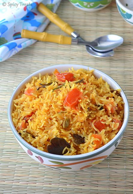 Tomato Biryani      This is my Mom version. I love this simple Biryani style Tomato rice n she often make this during Sundays of Purattasi(Tamil Month) becuase in that month we don't eat Non-vegetarian n eggs. So our cravings ends simply with this flavor rich n spicy masala rice. This tomato rice tastes excellent with seeraga samba rice.But u can cook with basmati or sona masoori or any regular cooking rice. Good idea for any party or any special occasion and also easy,simple,flavorfu