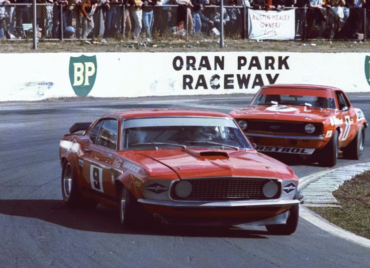Allan Moffat in the Trans Am Mustang leading Bob Jane in the Camaro into the main straight at Oran Park